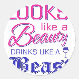 Looks like a beauty drinks like a beast classic round sticker