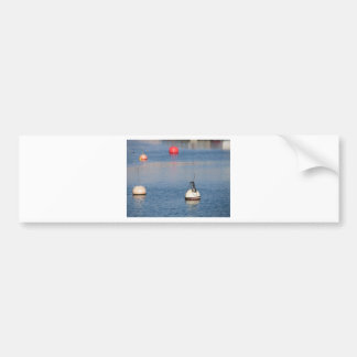 Lots of mooring buoys floating on calm sea water bumper sticker