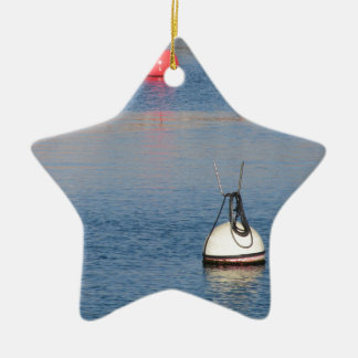 Lots of mooring buoys floating on calm sea water ceramic ornament