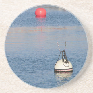 Lots of mooring buoys floating on calm sea water coaster