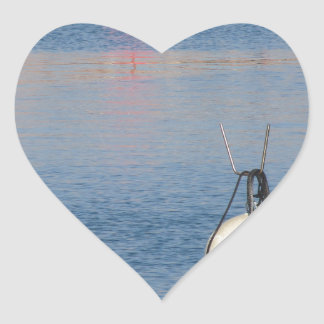 Lots of mooring buoys floating on calm sea water heart sticker