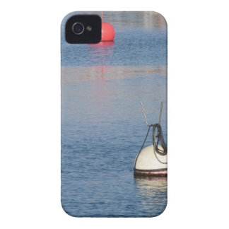 Lots of mooring buoys floating on calm sea water iPhone 4 cover