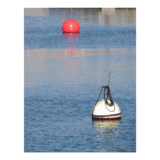 Lots of mooring buoys floating on calm sea water letterhead