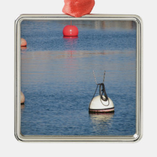 Lots of mooring buoys floating on calm sea water metal ornament
