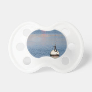 Lots of mooring buoys floating on calm sea water pacifier