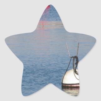 Lots of mooring buoys floating on calm sea water star sticker