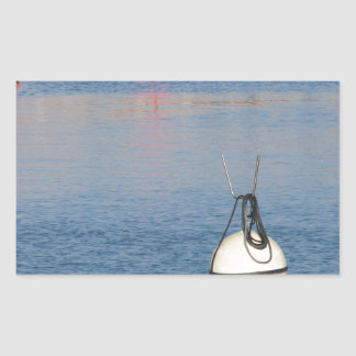 Lots of mooring buoys floating on calm sea water sticker