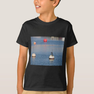Lots of mooring buoys floating on calm sea water T-Shirt