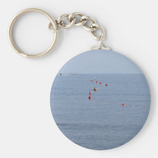 Lots of mooring buoys floating on water in marina basic round button keychain