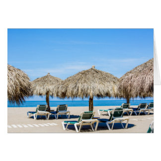 Lounge Chairs And Thatch Umbrellas On Beach Card