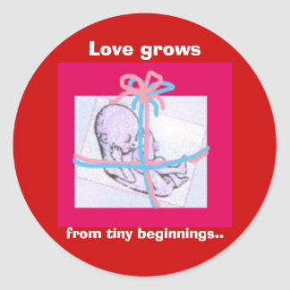 Love grows from tiny beginnings.. round sticker