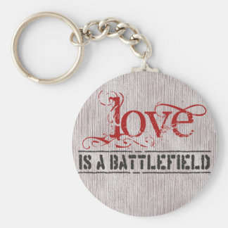 LOVE IS A BATTLEFIELD KEYCHAIN