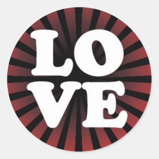LOVE on a Red and Black Starburst Round Sticker