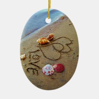 Love on beach w/  hearts ceramic ornament