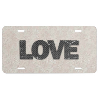 Love Word on soft pink lace background License Plate
