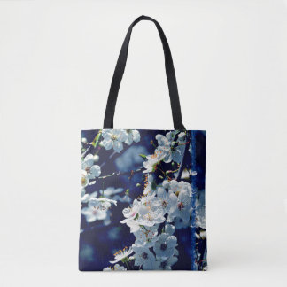 Lovely white plum blossoms on deep blue tote bag