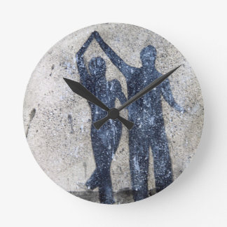 Lovers dancing in rain round clock