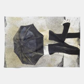 Lovers with umbrella in rain towel