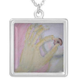 Loving hand on breast necklace. silver plated necklace