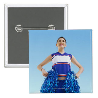Low angle view of a cheerleader holding her 2 inch square button