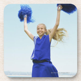 low angle view of a cheerleader holding up drink coasters