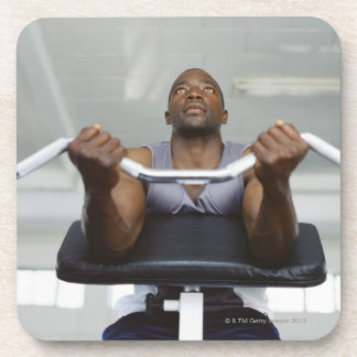 Low angle view of a mid adult man exercising in coasters