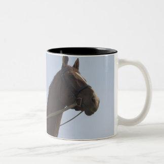 Low angle view of a teenage girl riding a horse Two-Tone coffee mug