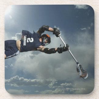 Low angle view of jai-alai player jumping coaster