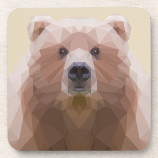 Low poly bear plastic coaster. Beige background. Coaster