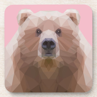 Low poly bear plastic coaster. Pink background. Coaster