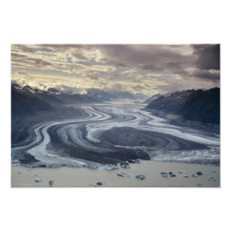 Lowell Glacier flows into the Alsek River in Photo