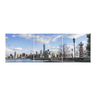 Lower Manhattan Skyline with Lighthouse Triptych Canvas Print