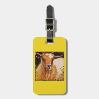 luggage tag with white and tan goat