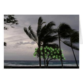 Lumières de vacances sur des palmiers carte de vœux