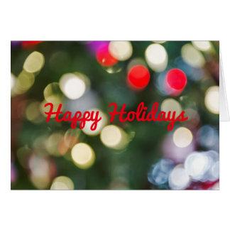 Lumières Defocused d'arbre de Noël avec la Carte De Vœux