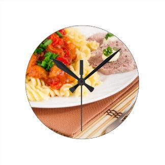 Lunch dish of Italian pasta, vegetable sauce Round Clock