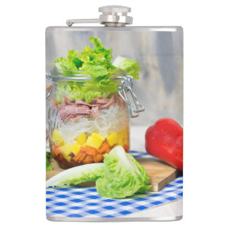 Lunch in a glass hip flask