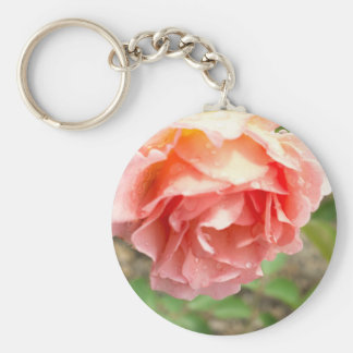 Luscious pink rose with morning dew. key chains