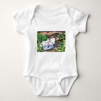 Lying lamb between nettle plants baby bodysuit