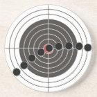 Machine gun bullet holes over shooting target coaster