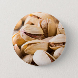 Macro close-up view of a group of salted pistachio 2 inch round button