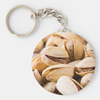Macro close-up view of a group of salted pistachio basic round button keychain