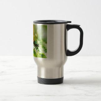 Macro damselfly on fern coffee mug