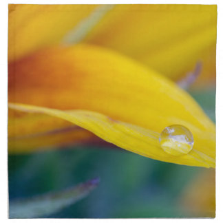Macro drop on the sunflower petal napkin