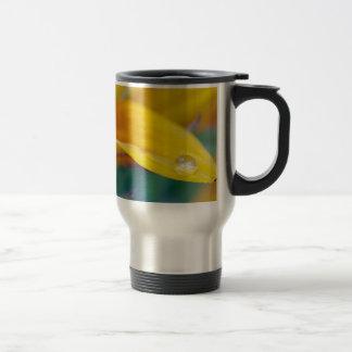 Macro drop on the sunflower petal travel mug