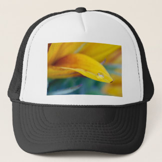 Macro drop on the sunflower petal trucker hat