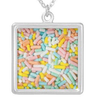 Macro image of a small scoop of pastel-colored silver plated necklace