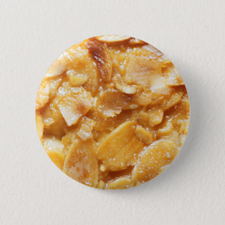 Macro of almond splitters on a cake 2 inch round button