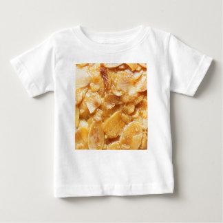 Macro of almond splitters on a cake baby T-Shirt