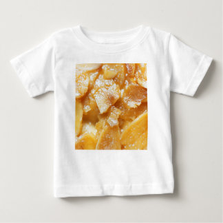 Macro of almond splitters on a cake baby T-Shirt